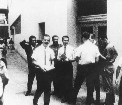 Lee Oswald leafleting in front of International Trade Mart in New Orleans